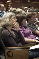 Attendees during a plenary session presentation.