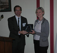 Craig Schiffries presents award to Lori Rowley
