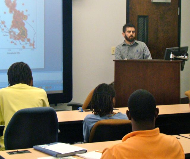 Stephen presents his seismological research to physics majors at Alabama A&M University